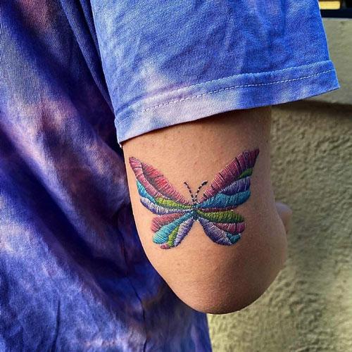 tatuaje estilo bordado de una mariposa