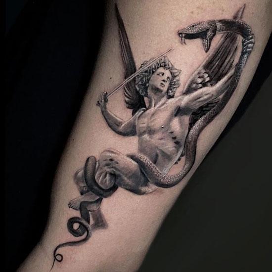 angel peleando tatuaje