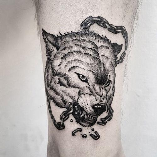 tatuaje en tobillo lobos