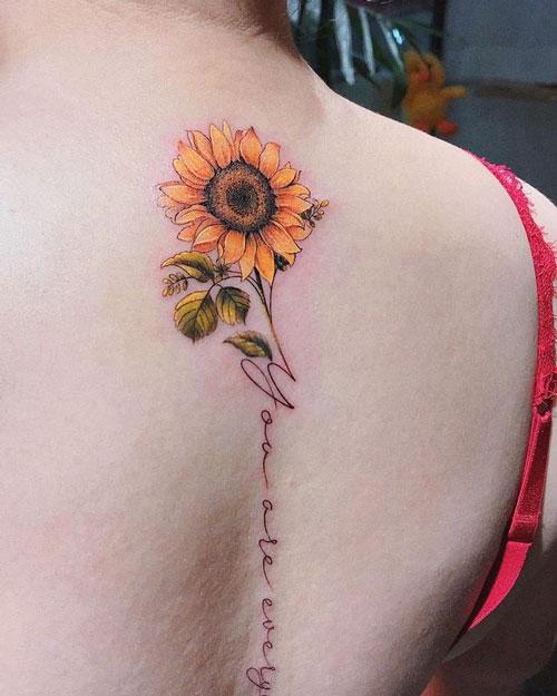 tatuaje girasol con frase