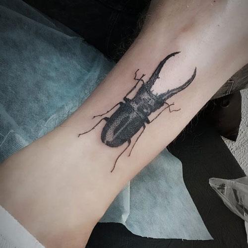 escarabajo tattoo