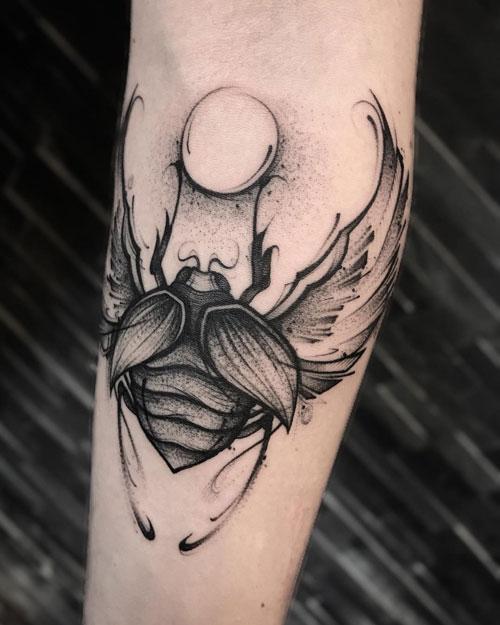 tatuaje escarabajo y el sol