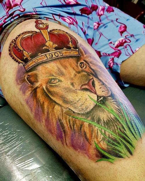 Tattoo leon en pierna