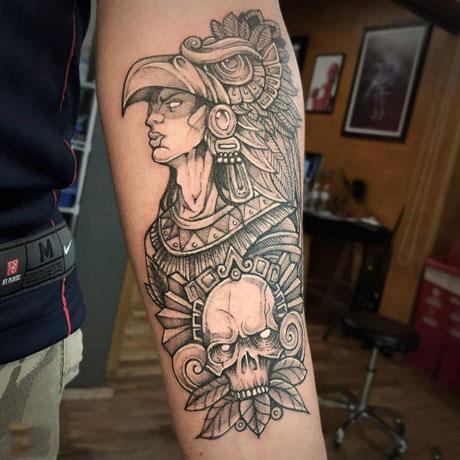 calavera y guerrero tatuaje