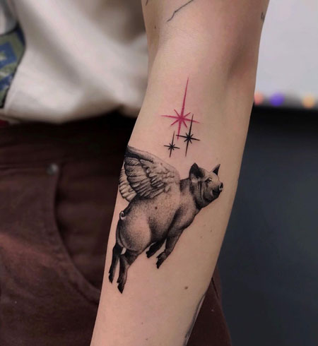tattoo cerdo volando