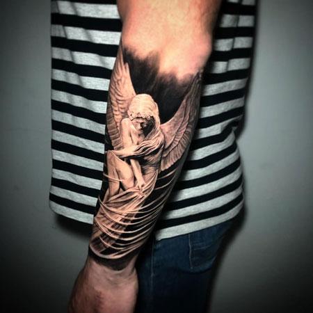 tatuajae estatua de angel