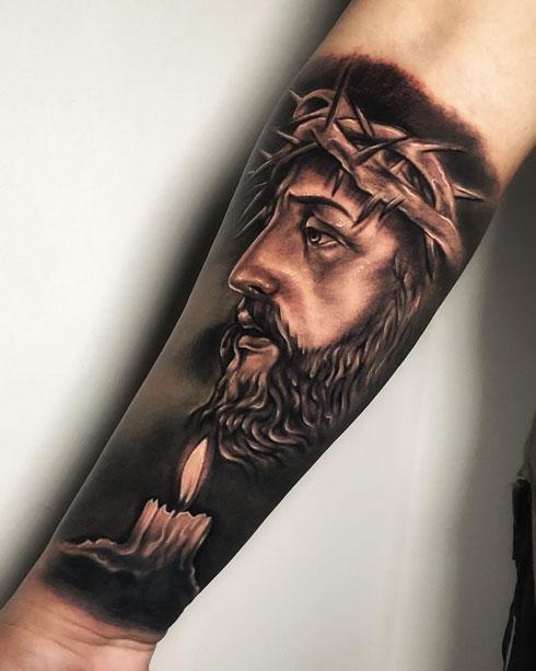 tatuaje cristo y vela