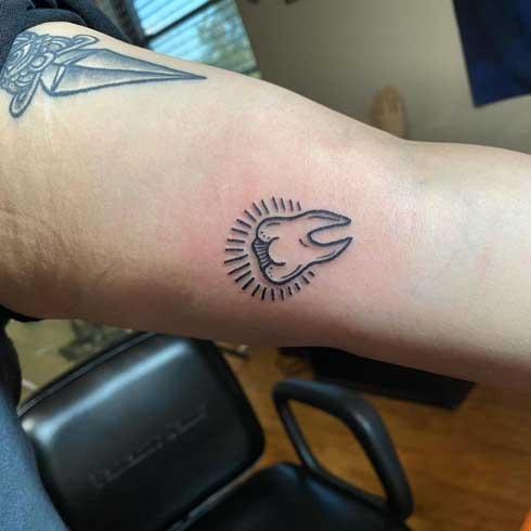 muela tattoo