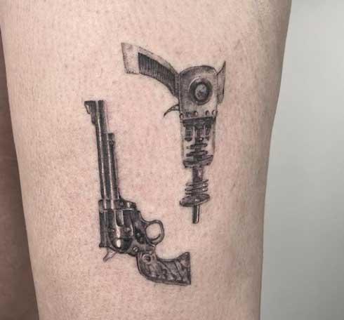 tatuaje de pistolas