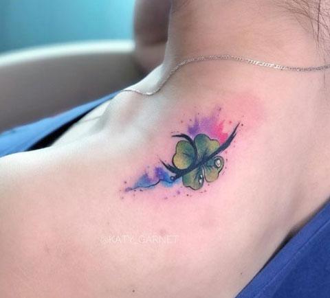 aqua color tattoo trebol