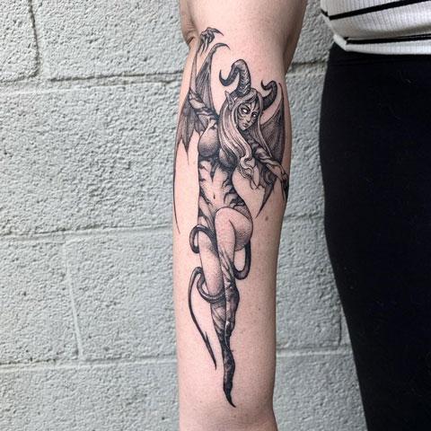 demonio con alas tattoo