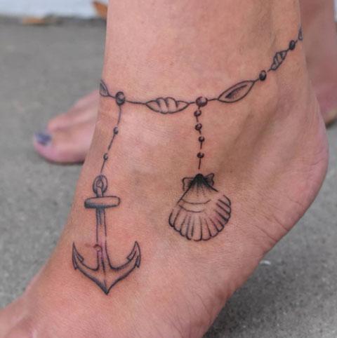 tatuaje brazalete concha marina