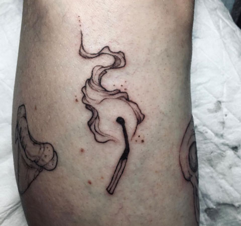 tatuaje de cerilla